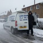 Van man delivering in the snow in Bilston