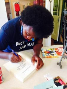 Zukiswa Wanner autographs a book at Ike's bookstore in Durban, South Africa