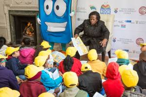 Deputy minister for Arts Rejoice Mabudafhasi reads to kids at the launch.