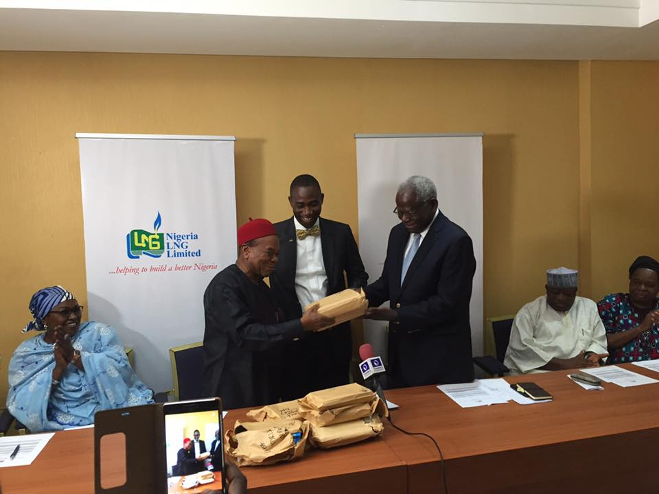 Professor Ayo Banjo hands over entries to chairman, panel of judges, Prof Ernest Emenyonu