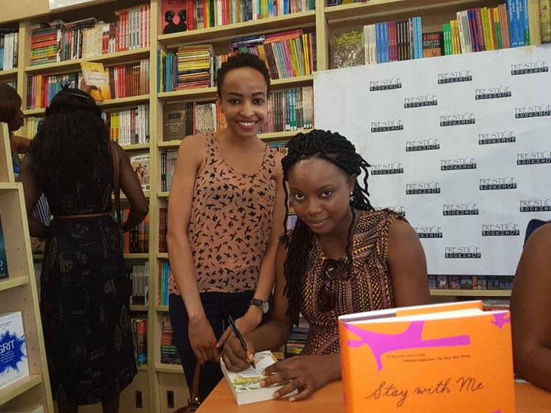 Ayobami Adebayo with a fan at Prestige Books