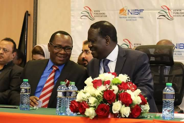 Lawrence Njagi with Raila Odinga