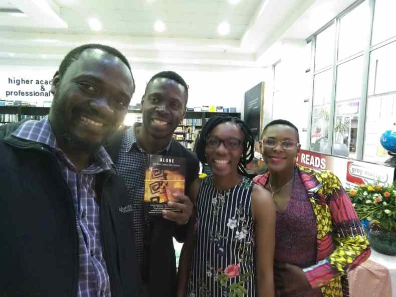 Henry Joe Sakala, a book buyer, Grace Kubikisha, and Ingrid Nayame