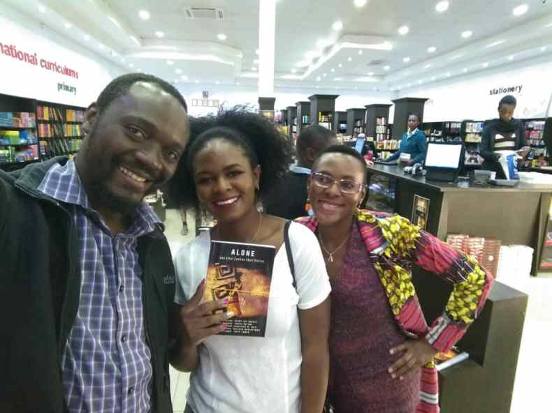 Henry Joe Sakala, a book buyer, and Ingrid Nayame