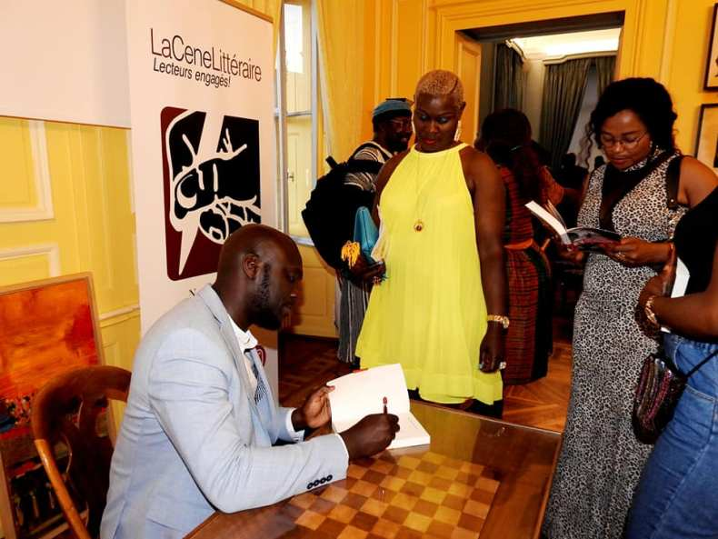 Elnathan John signs books in Geneva