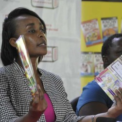 Dawn Makena Managing Director Story Moja shows some of the titles approved by the Kenya Institute of Curriculum Development KICD