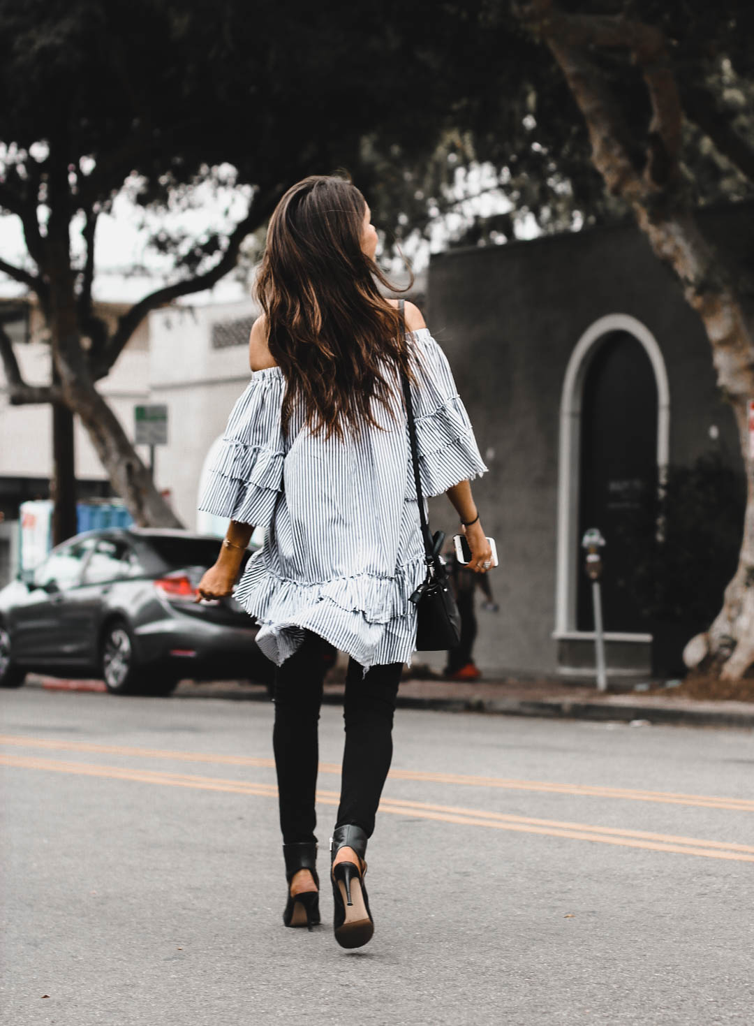 photo of jami alix wearing zara ruffle dress for street style blog post