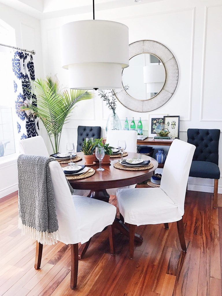 Modern coastal dining room with panel molding slipcovered chairs and blue and white accents-refresh your home decor