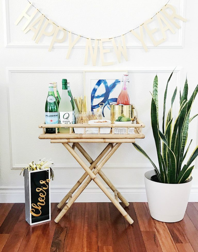 Put together a gorgeous bar cart for your New Year's Eve party-all the essentials for a stylish bar cart or drink station.