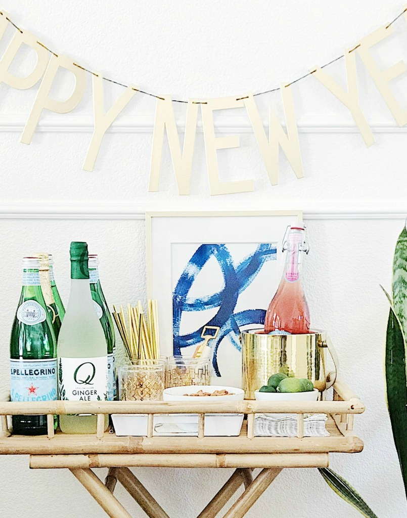 Fun bar cart styling for your New Year's Eve party-all the essentials for a stylish bar cart or drink station.