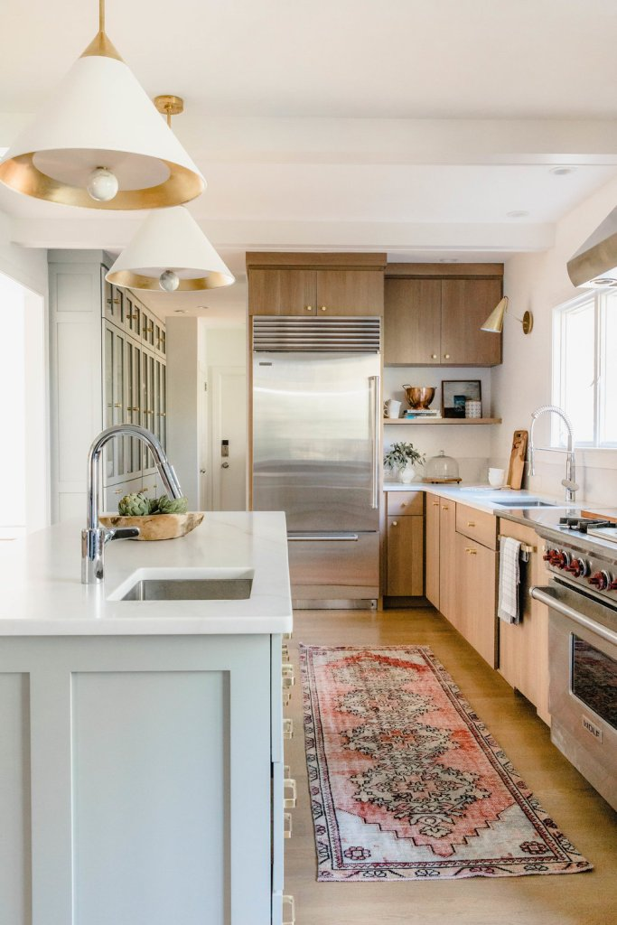 Rehabitat Interiors gorgeous wood and white kitchen with vintage rug