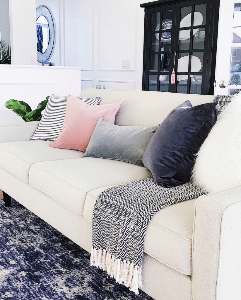 Think Pink - Adding touches of pink in the living room sofa with a blush pink pillow