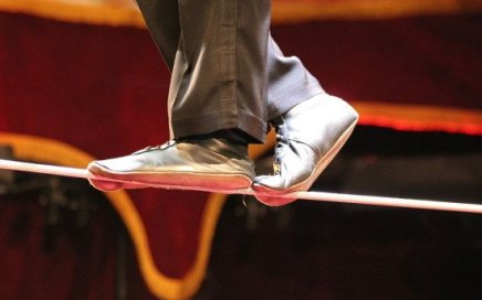 Close-up of feet on a tightrope