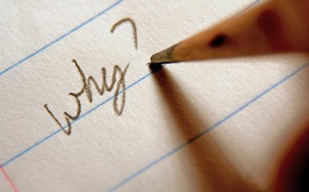 "Image: pencil writing the question ""Why?"" on paper"