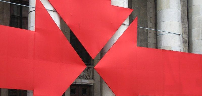 Image: three large arrows pointing to doorway