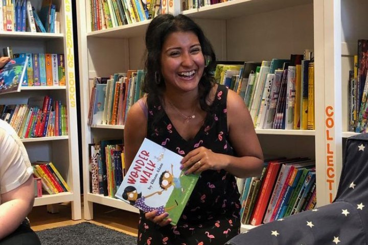 Image: author reading at children's library