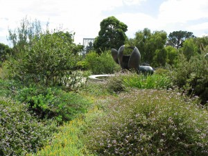 herb beds with sculpture