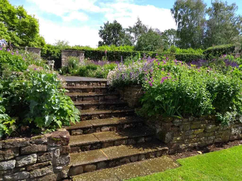 Stone steps and cascading flowers