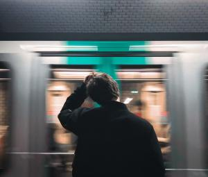 a man waiting at a subway