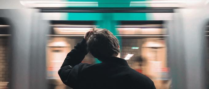 a man waiting at a subway