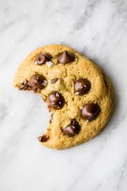 a chocolate chip cookie with a big bite in it.