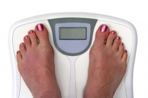 woman's feet on a scale