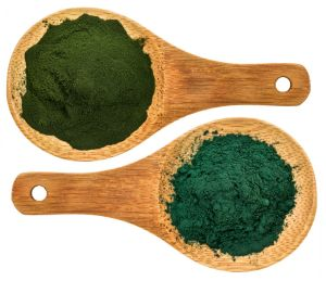 Chlorella ans spirulina supplemt powder - top view of isolated wooden