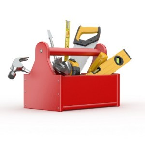 a red toolbox with hammers, screwdrivers, and saws in it