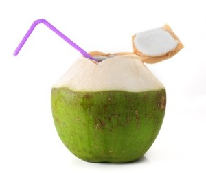 a raw coconut with a straw coming out of the top