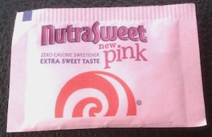 a pink packet of NutraSweet Pink