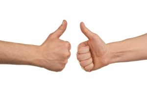 two hands doing a thumbs up