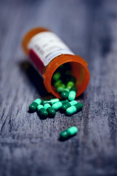 a bottle of medicine spilled pills out