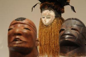 three wooden African masks