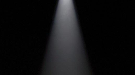 a spotlight in a dark room