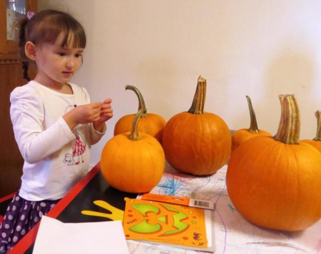 Emma Putting Sticker on Her Pumpkins