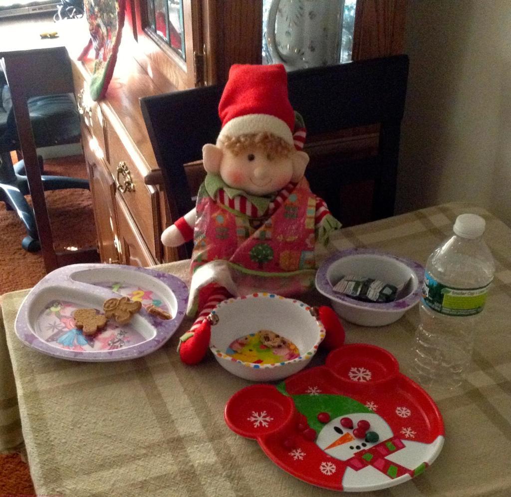 Gingerbread Feasting On Santa's Cookies!