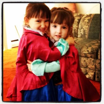 Their Girls Dressed in Their Matching Anna Frozen Costumes