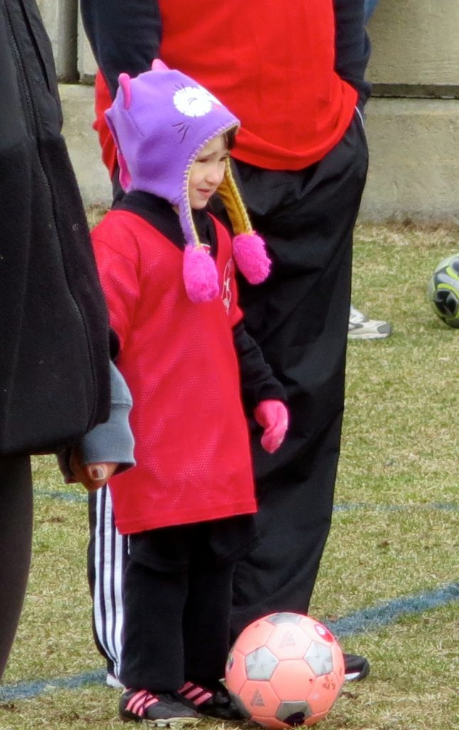 Emma Dressed for Winter, but Playing Spring Soccer!
