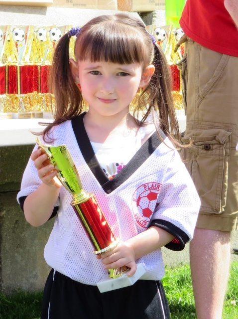 Emma - End of Spring Soccer with her Trophy
