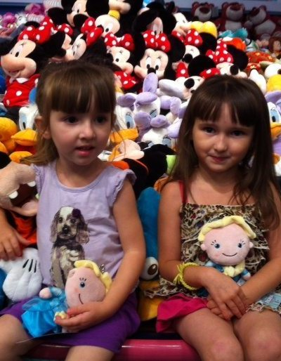 The Girls Hanging with the Stuffed Animals at the local Disney Store.