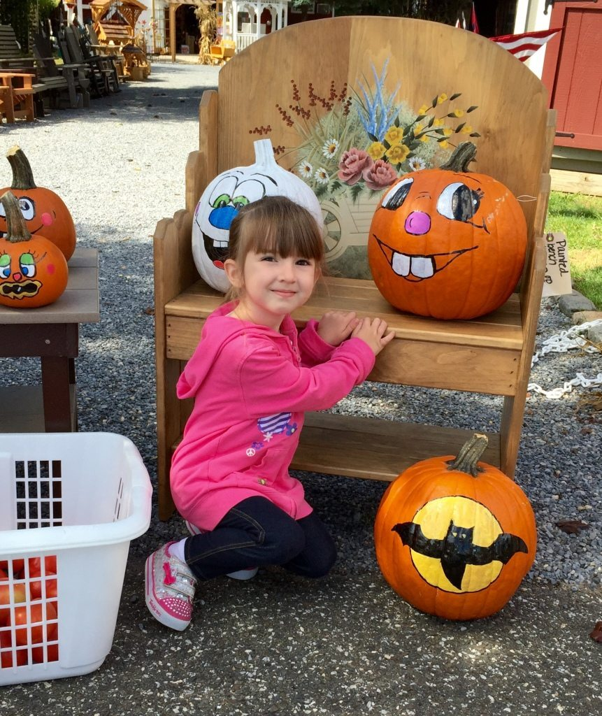 Lily Posing with Pumpkins