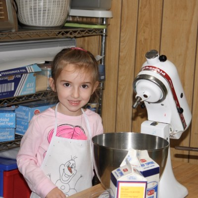 Getting Ready to Make Her Cake