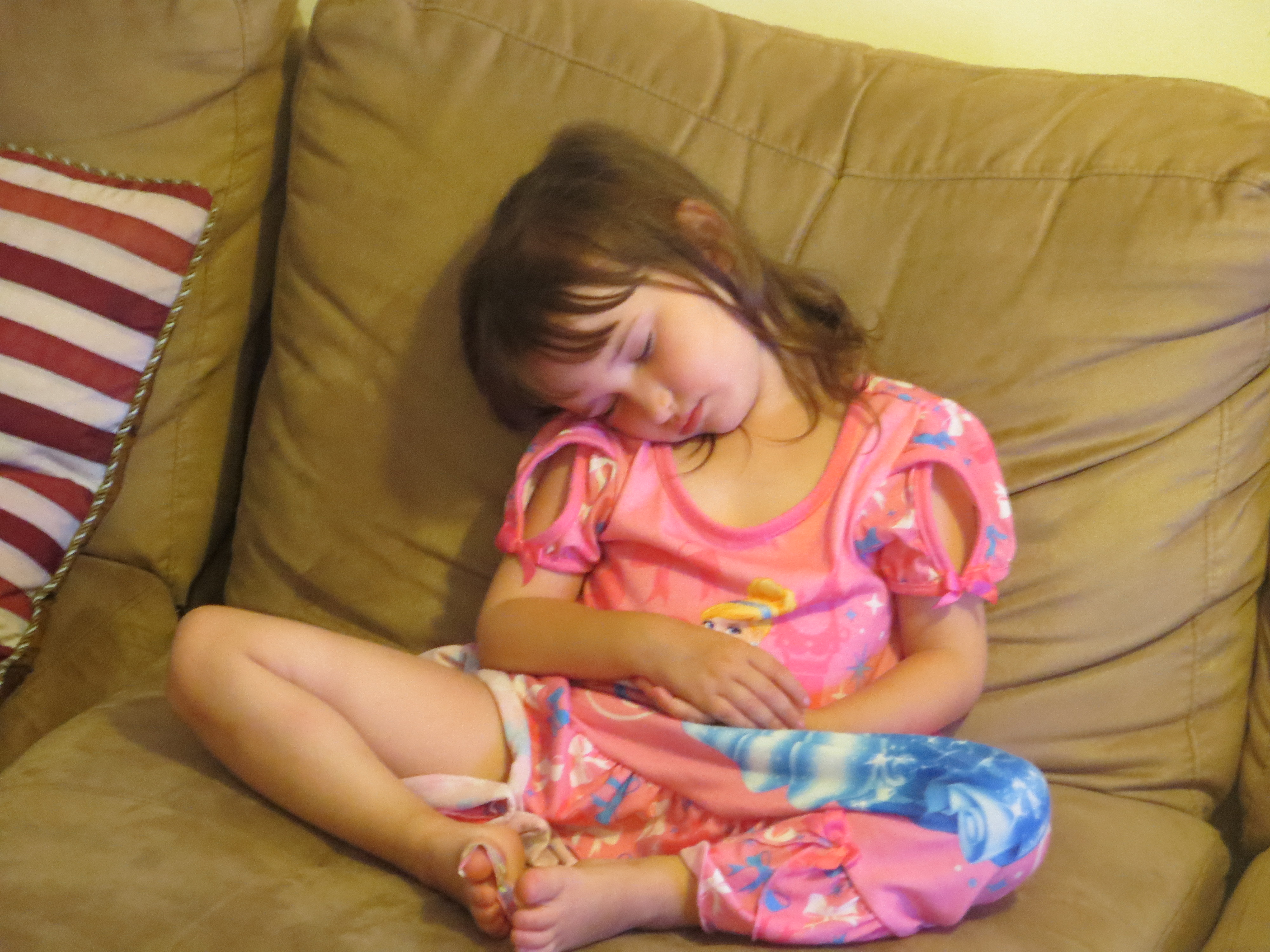Emma at 2 or 3 sleeping on the couch