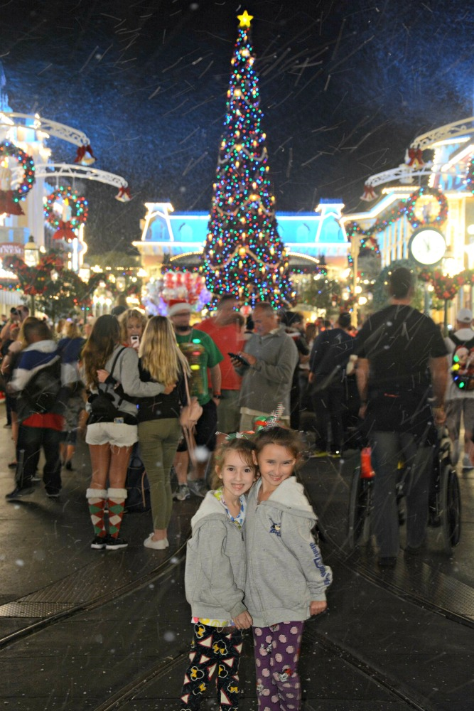 Girls in Front of Christmas Tree on Main Street at Mickeys Very Merry Christmas Party