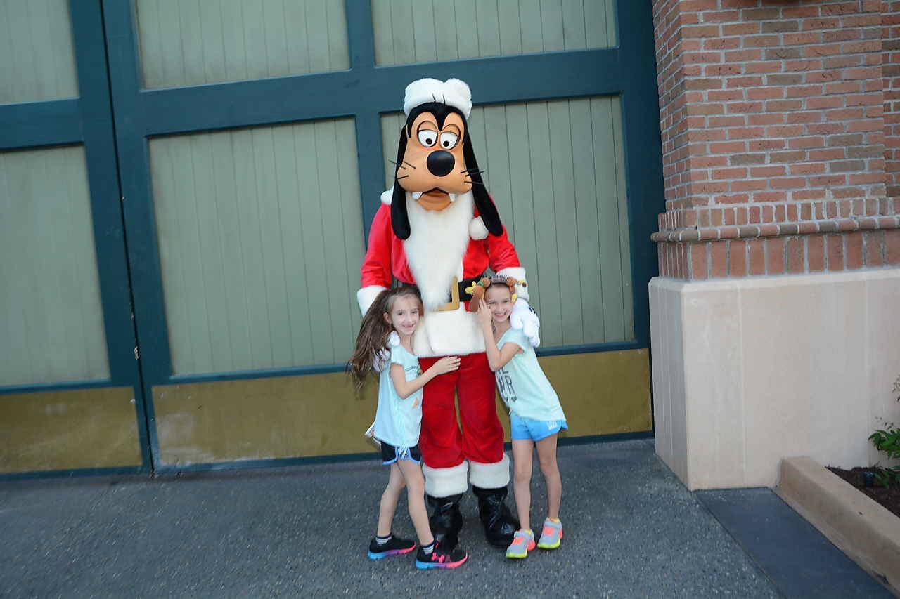 The girls with Santa Goofy at Disney Hollywood Studios