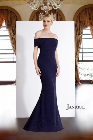 Off shoulder shimmer navy designer dress. Jersey gown with straight across off the shoulder sleeve by Janique in navy.