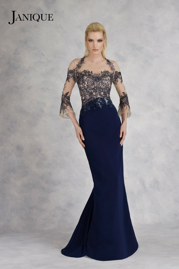 Beaded bodice evening wear dress with belled ballet-length sleeves by Janique. MOB gown with embroidery in navy with sleeve.