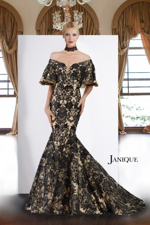 Off shoulder dress with embroidery lace. Black and nude mermaid dress by Janique. Lace gown with ruffle half sleeve.