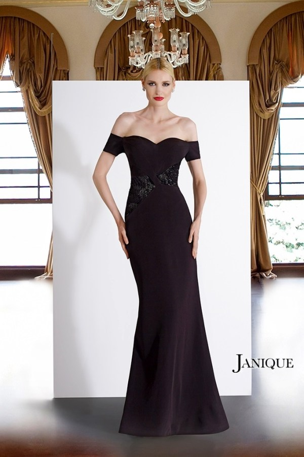Stretch crepe with embroidery on the bodice dress by Janique. Off the shoulder beaded bodice stretch crepe gown in black.