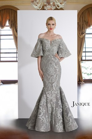 Lace embroidered gown with train by Janique in silver. Silver off the shoulder lace long dress with bell short sleeves.